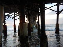 The underneath of the Pier. The underneath of the Cocoa Beach pier on a cloudy day in Cocoa Beach, Florida stock image