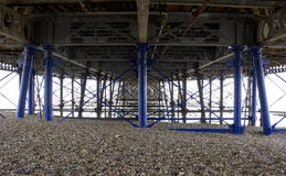 Underneath Eastbourne Beach Pier in the Summer Sunshine. Under the pier in Eastbourne, UK and it`s Victorian Architecture royalty free stock photography