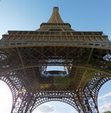 Underneath the Eiffel Tower. Paris - August 1, 2017: A view of the underside of the Eiffel Tower on a sunny day in August of 2017 stock images