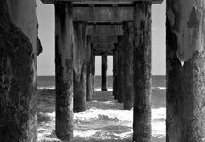 Underneath fishing pier background stock photo