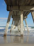Underneath the Fishing Pier and Boardwalk on Wrightsville Beach, North Carolina. View from under the fishing pier on Wrightsville Beach, NC, USA Royalty Free Stock Image