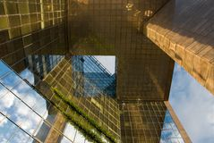 Underneath glass building. Strange view under glass building royalty free stock photography