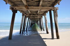 Underneath the Grange Jetty Pylons. Looking up from the beautiful Grange Jetty beach in sunny South Australia, the rustic beauty of the jetty is highlighted in Royalty Free Stock Photos