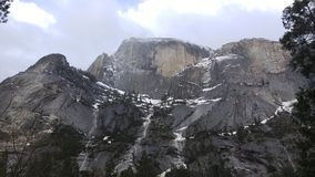 Underneath Half Dome. The beauty and size of this majestic mountain makes one feel a lot smaller and in awe when at the very base Stock Photo