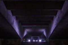 Underneath an illuminated Waterloo Bridge Royalty Free Stock Photo