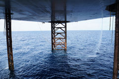 Underneath Jack Up Drilling Rig. In The Ocean - Oil and Gas Industry stock images
