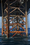 Underneath Jack Up Drilling Rig In The Ocean Stock Photos