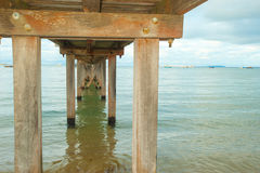 Underneath a jetty with wood bracing. Underneath a jetty with architectural shape in Port Phillip Bay, Melbourne Stock Photos