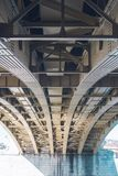 Underneath a large ark bridge. Beautiful architecture stock photo