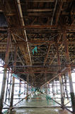 Underneath large bridge. A view of the bottom and supporting structure of a large bridge stock images