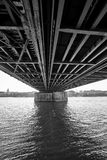 Underneath the marvelous Hohenzollern Bridge spanning the Rhine river in Cologne, Germany. A black & white rendition revealing the construction marvel of stock photos