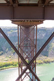 Underneath the old Perrine Bridge at Twin Falls. View looking along the metal supports of the span underneath the old Perrine Bridge as it crosses the Snake royalty free stock photo