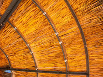 Underneath of Outdoor Umbrella, background. Close up of internal structure of outdoor sun shade umbrella with metal beams and rings and wooden sticks royalty free stock images