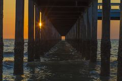 Underneath the pier with sunset. Landscape view underneath the bridge with sunset stock photo