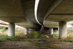 Underneath the A4 road bridge in Bath, UK. Concrete pillars carry one of the UK's major roads across the River Avon in Somerset stock image