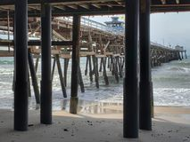 Underneath San Clemente Pier. Taken at the San Clemente Pier in Southern California royalty free stock photos