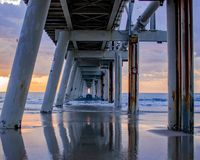 Underneath a sand jetty royalty free stock photo