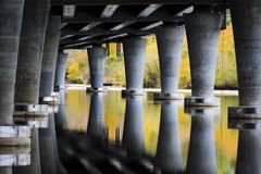 Underneath the State Route 520 bridge in Seattle USA. Calm water under Seattle`s State Route 520 Bridge near park land royalty free stock images