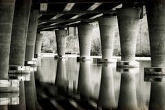 Underneath the State Route 520 bridge in Seattle USA. Calm water under Seattle`s State Route 520 Bridge near park land royalty free stock photo