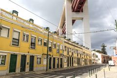 Underneath the 25th of April Bridge. Quiet residential street directly underneath the access to the 25th of April suspension bridge in Lisbon, Portugal royalty free stock images