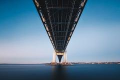 Underneath Verrazano Narrows Bridge. Long exposure from under the bridge royalty free stock photography