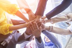 Underneath view of business people hands together and teamwork concept. Underneath view of business people hands together and teamwork concept Stock Images