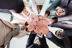 Underneath view hands. Underneath view of business people hands together stock photos