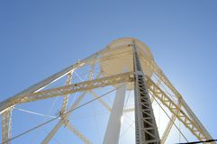 Underneath A Water Tower. A view from underneath a tall metal water tower royalty free stock photo