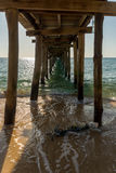 Underneath the wooden pier. View from underneath a wooden pier on a tropical island Stock Image