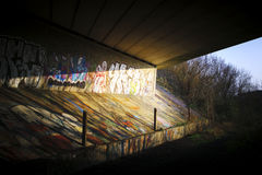 Underpass Graffiti. A road underpass painted with graffiti illuminted by the afternoon sun Royalty Free Stock Photos