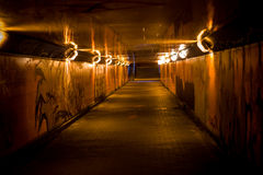 Dark underpass. Underpass with graffity on the walls and low light Royalty Free Stock Images