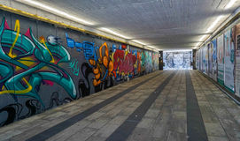 Underpass. Long underpass with colorful graffiti on the walls Royalty Free Stock Photo