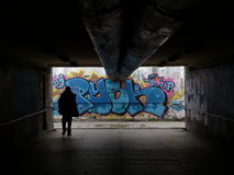Underpass. A man walking through an underpass in Opole Royalty Free Stock Image