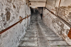 Underpass in the old town. Steps down to the underpass - descent with stairs to a narrow dark gallery in the old italian town Stock Images