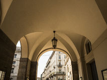 Underpass. From underpass, view from building arch to another building in Milano Royalty Free Stock Photo
