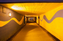 Underpass. With vivid yellow and blue colors at night Royalty Free Stock Images