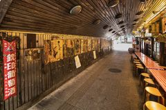 Underpass Yurakucho Concourse under the railway line of the stat. Ion Yurakucho. Japanese noodle stalls and sake bars revive the nostalgic years of Showa air royalty free stock image