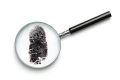 undersökande glass förstoring för fingeravtryck Arkivbild