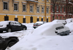Unders Snow. SAINT PETERSBURG, RUSSIA - JANUARY 7: Street in Saint Petersburg after snowstorm January 7, 2009 on the Russian Christmas day Royalty Free Stock Photo