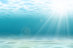 Undersea with light ray. Abstract undersea background, white sand with sun ray for your design Royalty Free Stock Photos