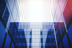 Underside angle view to textured background of modern glass blue building skyscrapers. Horizontal mockup. 3d render Royalty Free Stock Photography