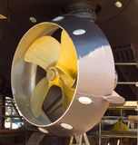 The underside of a big ocean-going tugboat under repairs at a facility in washington. A huge ship`s propeller exposed at a dry-dock by the pacific ocean Royalty Free Stock Photos