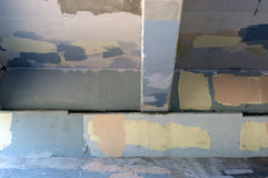 Underside of bridge graffiti painted over. Looking up at the underside of a bridge that has had graffiti painted over in various colors of paint making an Royalty Free Stock Photo