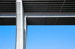 Underside of concrete bridge and pylon on sky. Stock Image