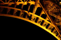 Underside of the Eiffel Tower at Night Stock Images