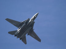 Underside of F-14 tomcat. Flying overhead against a blue sky Stock Image