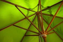 The underside of a green beach umbrella. The underside of a green wooden beach umbrella stock photo