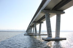 Underside of a large bridge over bay Royalty Free Stock Image