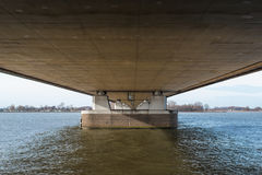 Underside of a long bridge in the Netherlands Royalty Free Stock Photography