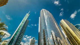 Underside panoramic and perspective view to steel glass high rise building skyscrapers timelapse hyperlapse, Dubai, UAE. Underside panoramic and perspective view stock video footage